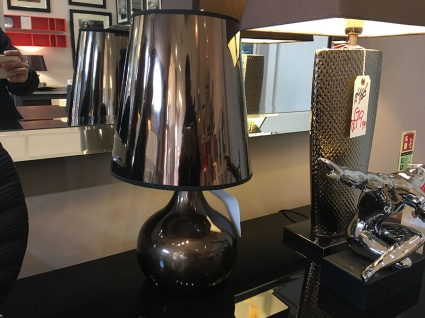Small bronze table lamp display
