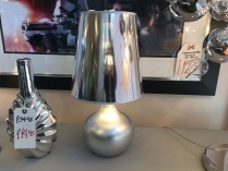 Small silver table lamp display