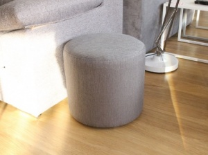 Round fabric pouf in light grey