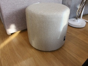 Round fabric pouf in beige